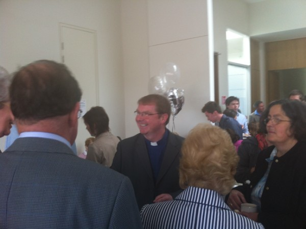 Fr. Brendan surrounded by well-wishers